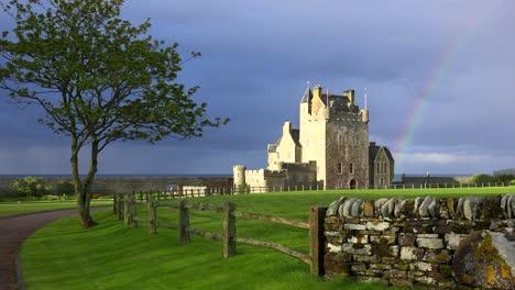 Establishing-shot-of-a-beautiful-Scottish-or-English-castle-estate-in-sunset-light-with-rainbow-background-1