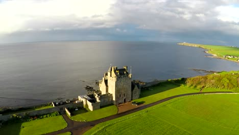 An-aerial-of-a-beautiful-Scottish-or-English-castle-estate-in-sunset-light