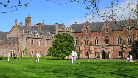 Seniors-play-croquet-on-the-grounds-of-an-elaborate-mansion-in-Great-Britain-1