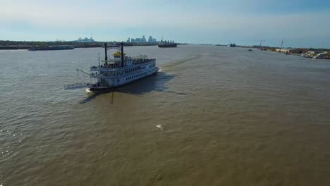 Very-good-aerial-over-a-paddlewheel-steamer-on-the-Mississippi-River-with-the-New-Orleans-skyline-in-distance
