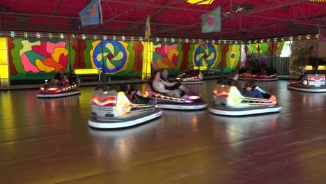 Bumper-cars-go-around-in-circles-at-an-amusement-park