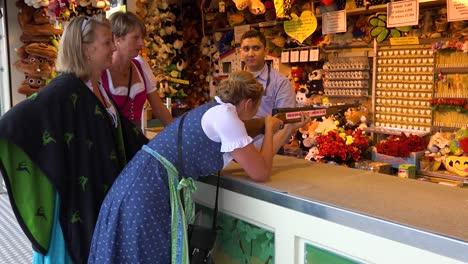 German-girls-practice-their-skills-at-target-practice-at-Oktoberfest-Germany
