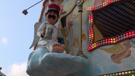 An-animated-German-figure-raises-his-beer-glass-during-Oktoberfest-in-Munich