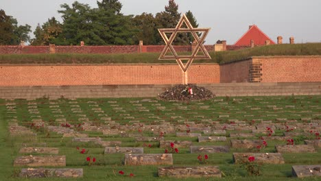 Jewish-menorah-cemetery-memorial-at-the-Terezin-Nazi-concentration-camp-in-Czech-Republic