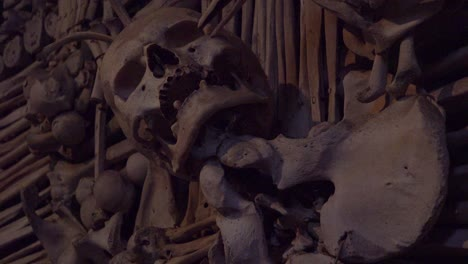 Skulls-and-bones-hang-from-the-walls-at-the-Sedlec-Ossuary-in-the-Czech-Republic