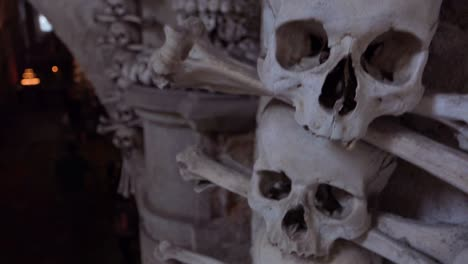 Skulls-and-bones-hang-from-the-walls-at-the-Sedlec-Ossuary-in-the-Czech-Republic-1