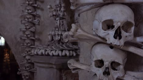 Skulls-and-bones-hang-from-the-walls-at-the-Sedlec-Ossuary-in-the-Czech-Republic-2