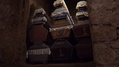 Coffins-are-piled-inside-a-tomb-in-Vac-Hungary