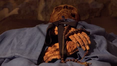 A-male-mummy-hands-hold-a-cross-in-a-crypt-in-Vac-Hungary-2