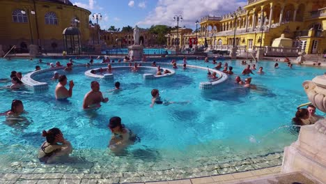 People-bathe-and-swim-in-a-beautiful-old-bath-and-spa-in-Budapest-Hungary