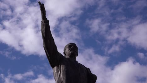 Time-lapse-behind-old-Lenin-statue-rusting-in-Memento-Park-outside-Budapest-Hungary
