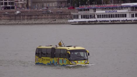 An-amphibious-tour-bus-travels-down-the-Danube-River-in-Budapest-Hungary