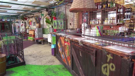 Establishing-shot-of-the-interior-of-a-ruin-bar-trendy-hangout-in-Budapest-Hungary