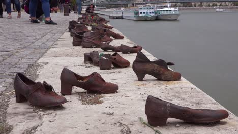 Visitors-remember-victims-of-the-Holocaust-at-the-Shoes-Along-The-Danube-Memorial-in-Budapest-Hungary-1