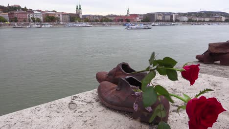 Visitors-remember-victims-of-the-Holocaust-at-the-Shoes-Along-The-Danube-Memorial-in-Budapest-Hungary-2