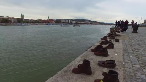 Visitors-remember-victims-of-the-Holocaust-at-the-Shoes-Along-The-Danube-Memorial-in-Budapest-Hungary-3