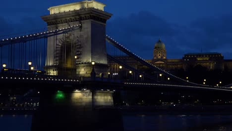 Night-view-beside-an-illuminated-bridge-over-the-Danube-River-in-Budapest-Hungary-3