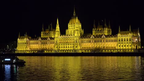 The-beautiful-parliament-building-glows-in-evening-light-along-the-Danube-River-in-Budapest-Hungary