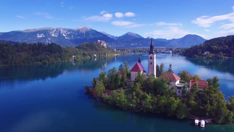 Gorgeous-aerial-shot-flying-over-Lake-Bled-and-island-castle-Slovenia-1