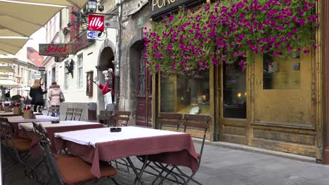 A-quaint-cafe-with-tables-and-chairs-in-Ljubljana-the-capital-of-Slovenia