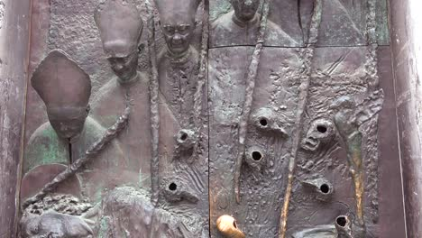 A-unique-metal-door-sculpture-in-ljubljana-Slovenia-features-the-Pope