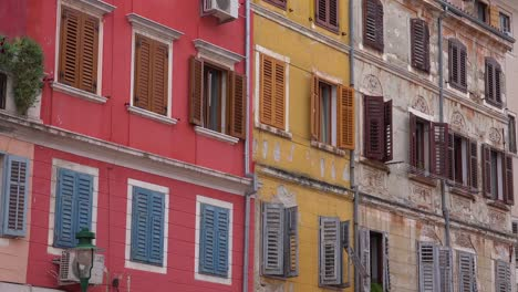 Windows-are-shuttered-during-the-off-season-in-the-narrow-alleys-of-Rovinj-in-Croatia