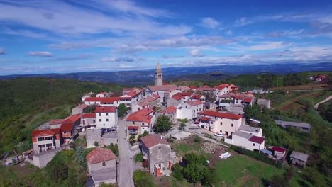 Gorgeous-aerial-of-a-small-Croatian-or-Italian-hill-town-or-village