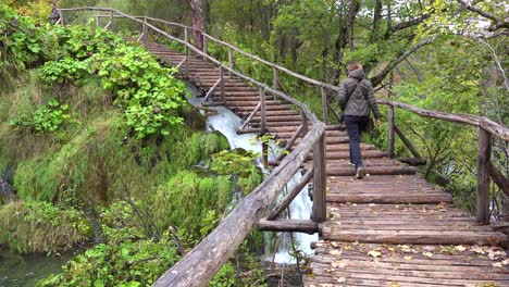 A-woman-walks-up-a-pathway-at-Plitvice-National-park