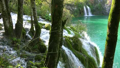Beautiful-waterfalls-flow-through-lush-green-jungle-at-Plitvice-National-Park-in-Croatia-3