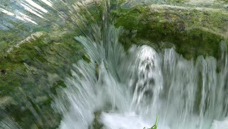 Beautiful-waterfalls-flow-through-lush-green-jungle-at-Plitvice-National-Park-in-Croatia-4