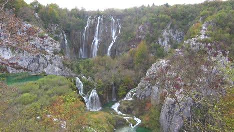 Beautiful-waterfalls-flow-through-lush-green-jungle-at-Plitvice-National-Park-in-Croatia-7