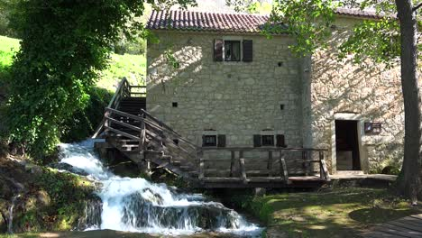A-waterfall-flows-beside-an-old-mill-in-Croatia-