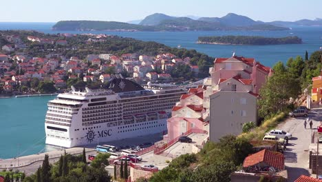 A-giant-cruise-ship-is-docked-in-the-bay-in-the-old-city-of-Dubrovnik-Croatia