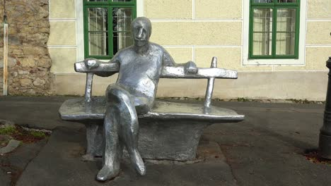 An-artistic-rendition-of-a-person-sitting-on-a-bench