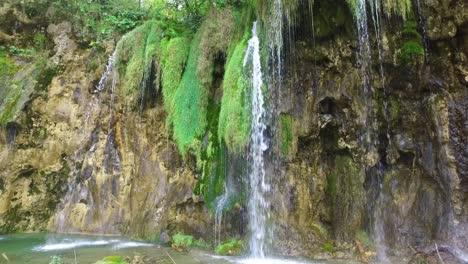 Beautiful-waterfalls-flow-through-lush-green-jungle-at-Plitvice-National-Park-in-Croatia-10