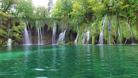 Beautiful-waterfalls-flow-through-lush-green-jungle-at-Plitvice-National-Park-in-Croatia-11