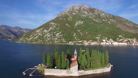 Beautiful-aerial-over-the-Our-Lady-rock-island-church-in-Boka-Bay-Montenegro-2