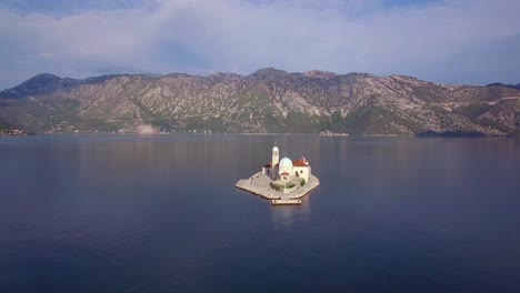 Beautiful-aerial-over-the-Our-Lady-rock-island-church-in-Boka-Bay-Montenegro-4