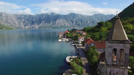 Stunning-aerial-of-an-attractive-village-on-the-shores-of-Boka-Bay-Montenegro-1