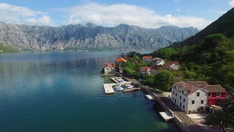 Stunning-aerial-of-an-attractive-village-on-the-shores-of-Boka-Bay-Montenegro-2