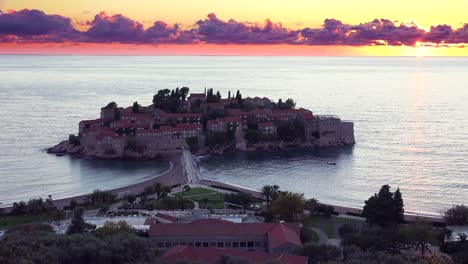 Remarkable-high-angle-sunset-shot-over-the-beautiful-Sveti-Stefan-island-in-Montenegro