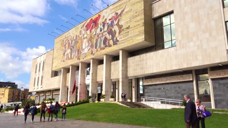 A-view-of-downtown-Tirana-Albania-streets-and-traffic-with-museum-and-revolutionary-Communist-mural