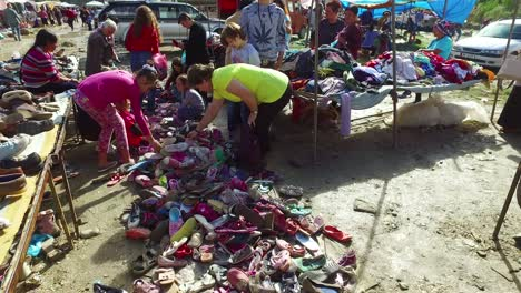 Moving-POV-shot-through-a-large-outdoor-flea-market-in-the-Alps-of-Albania