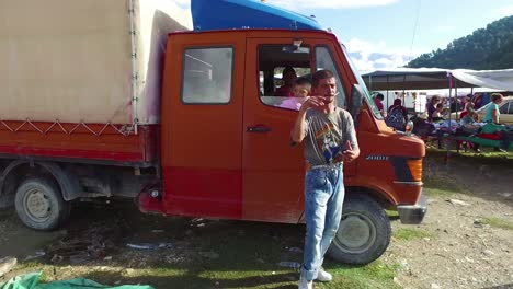 Moving-POV-shot-through-a-large-outdoor-gypsy-flea-market-in-the-Alps-of-Albania