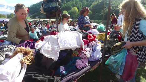 Moving-POV-shot-through-a-large-outdoor-gypsy-flea-market-in-the-Alps-of-Albania-3