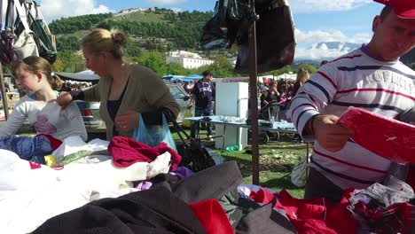 Moving-POV-shot-through-a-large-outdoor-gypsy-flea-market-in-the-Alps-of-Albania-4