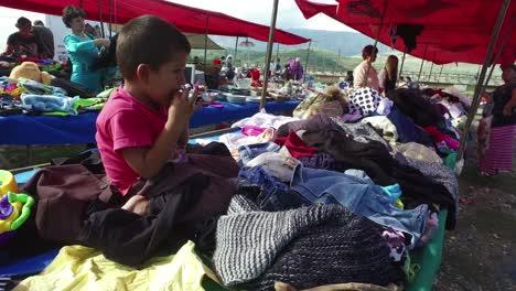 Little-boy-in-a-large-outdoor-gypsy-flea-market-in-the-Alps-of-Albania