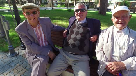 Albanian-men-sit-on-a-bench-in-the-park-and-enjoy-friendship-and-conversation