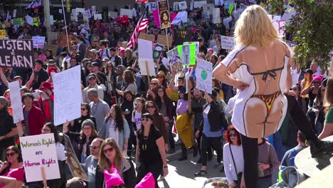 Hundreds-of-thousands-marching-and-carrying-signs-to-protest-the-presidency-of-Donald-Trump-in-downtown-Los-Angeles-California-2