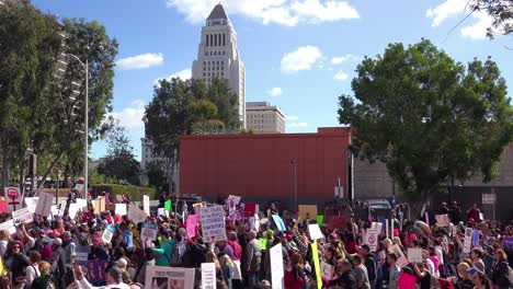 Hundreds-of-thousands-march-chant-and-carry-signs-to-protest-the-presidency-of-Donald-Trump-in-downtown-Los-Angeles-California-1